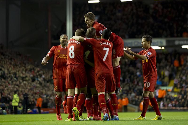 Liverpool's Daniel Sturridge is swamped by jubilant teammates including Jon Flanagan, top, after scoring against Sunderland during their English Premier League soccer match at Anfield Stadium, Liverpool, England, Wednesday March 26, 2014