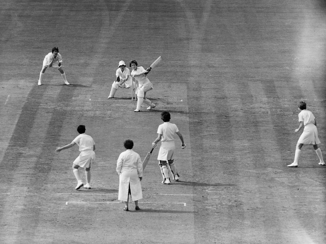 [ICCWWC2013] 20th July 1963:  English cricketer Rachel Heyhoe-Flint hits Australian M Knee to the boundary during England's first innings against Australia in the Women's Cricket Test match at the Oval in London.  (Photo by Central Press/Getty Images)
