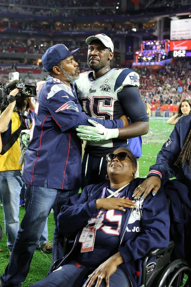 New England Patriots Chandler Jones #95 celebrates with his family after the NFL Super Bowl XLIX football game against the Seattle Seahawks on Sunday, Feb. 1, 2015, in Glendale, Ariz. (AP Photo/Gregory Payan)