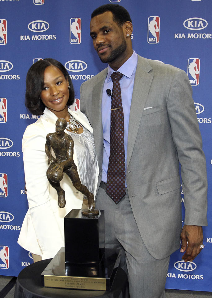 LeBron James (R) of the Cleveland Cavaliers poses with his girlfriend Savannah Brinson (L) and the NBA's Most Valuable Player award that was presented to him during a ceremony at the University of Akron in Akron, Ohio May 2, 2010.  REUTERS/Aaron Josefczyk (UNITED STATES - Tags: SPORT BASKETBALL)