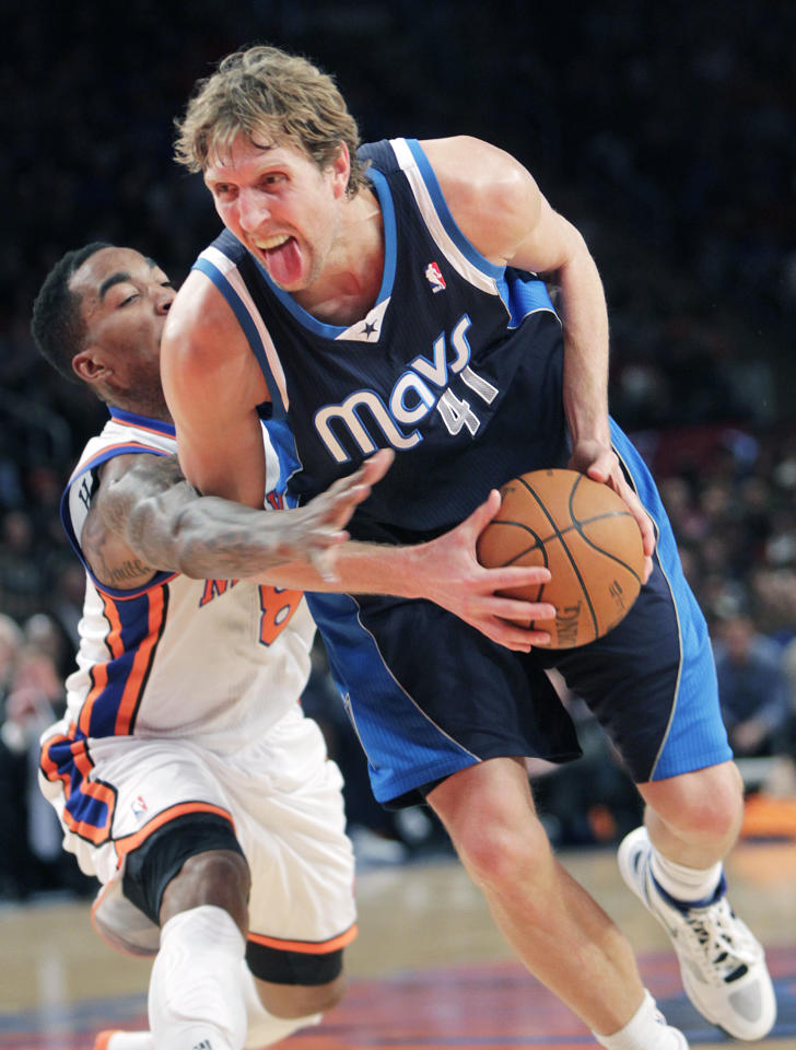 Dallas Mavericks' Dirk Nowitzki, right, is fouled by New York Knicks' J.R. Smith during the second half of an NBA basketball game in New York, Sunday, Feb. 19, 2012. The Knicks defeated the Mavericks 104-97. (AP Photo/Seth Wenig)