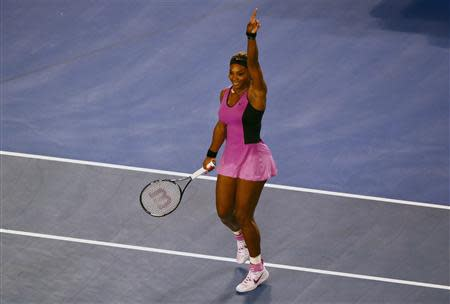 Serena Williams of the United States celebrates defeating Ashleigh Barty of Australia in their women's singles match at the Australian Open 2014 tennis tournament in Melbourne