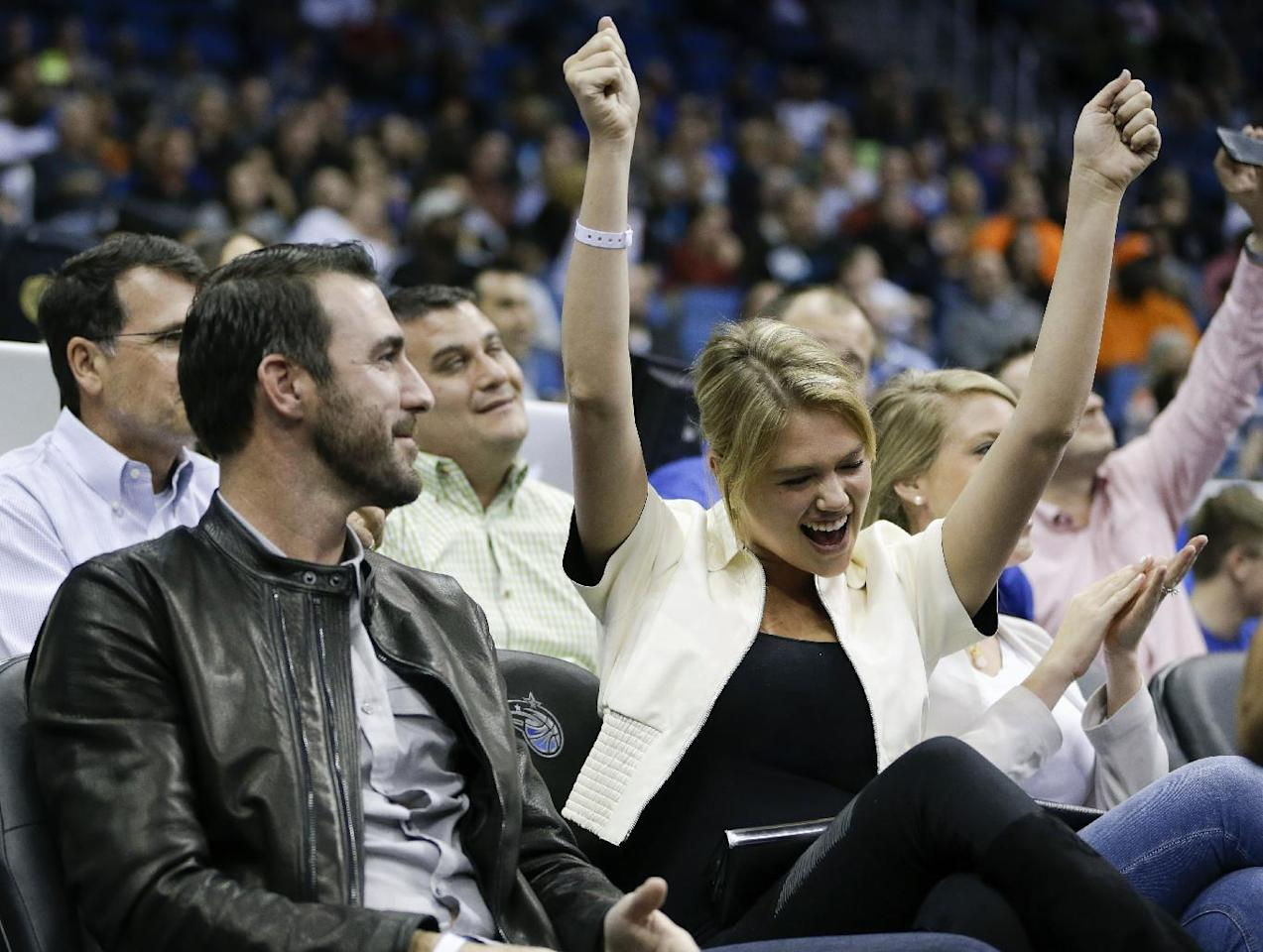 Detroit Tigers pitcher Justin Verlander, left, and model Kate Upton cheer during the first half of an NBA basketball game between the Orlando Magic and the Oklahoma City Thunder in Orlando, Fla., Friday, Feb. 7, 2014. (AP Photo/John Raoux)