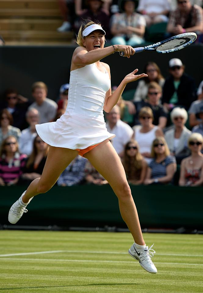 LONDON, ENGLAND - JUNE 26: Maria Sharapova of Russia plays a forehand during her Ladies' Singles second round match against Michelle Larcher de Brito of Portugal on day three of the Wimbledon Lawn Tennis Championships at the All England Lawn Tennis and Croquet Club on June 26, 2013 in London, England. (Photo by Dennis Grombkowski/Getty Images)