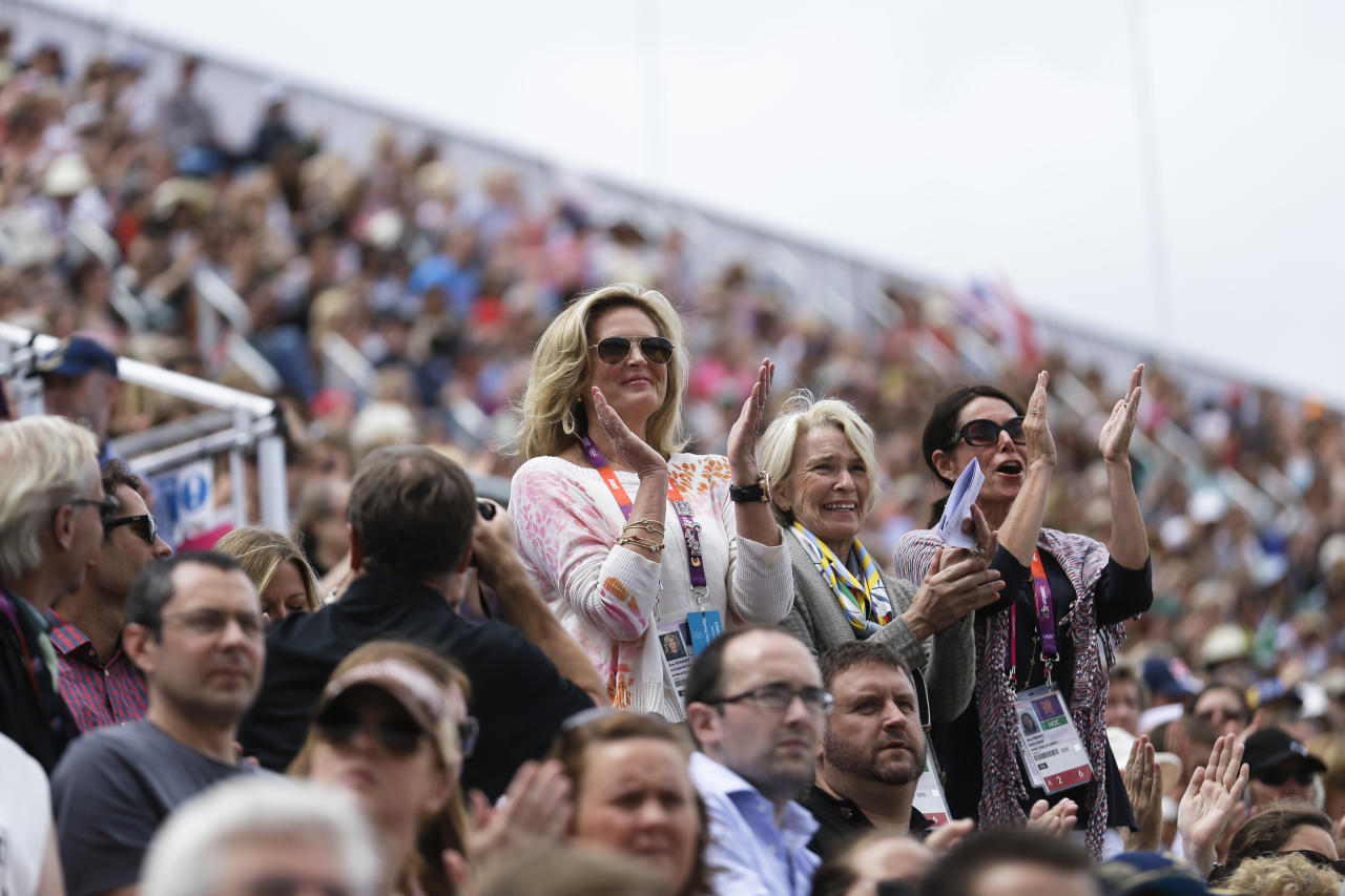 Ann Romney, left, the wife of U.S. Republican presidential candidate Mitt Romney applauses after her co-owned horse Rafalca attends in the equestrian  dressage competition, at the 2012 Summer Olympics, Thursday, Aug. 2, 2012, in London. (AP Photo/Markus Schreiber)