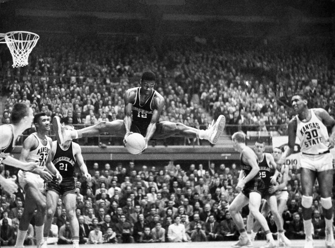 Oscar Robertson #12 of the Cincinnati Bearcats pulls in the rebound at the Shoemaker Center in Cincinnati, Ohio. (Photo by Cincinnati/Collegiate Images/Getty Images)