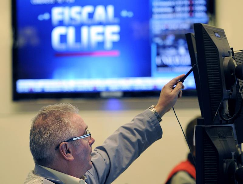 Stocks slide as impasse over budget deficit looms