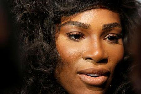 Tennis player Serena Williams speaks to the media as she arrives to present the Serena Williams Signature Statement Fall Collection at New York Fashion Week in Manhattan, New York, U.S., September 12, 2016.  REUTERS/Andrew Kelly