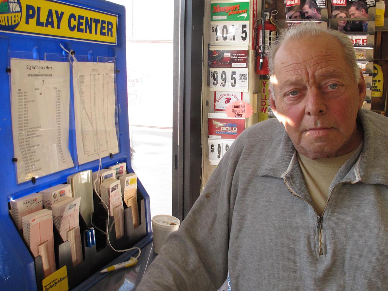 Raymond Parker mulls what he might do with the winning Powerball jackpot inside a stationery store in Long Beach, N.Y. on Monday, Nov. 26, 2012. The 67-year-old Long Beach resident, who's car was destroyed in Superstorm Sandy, said he is rooting for multiple winners of the $425 million jackpot. (AP Photo/Frank Eltman)