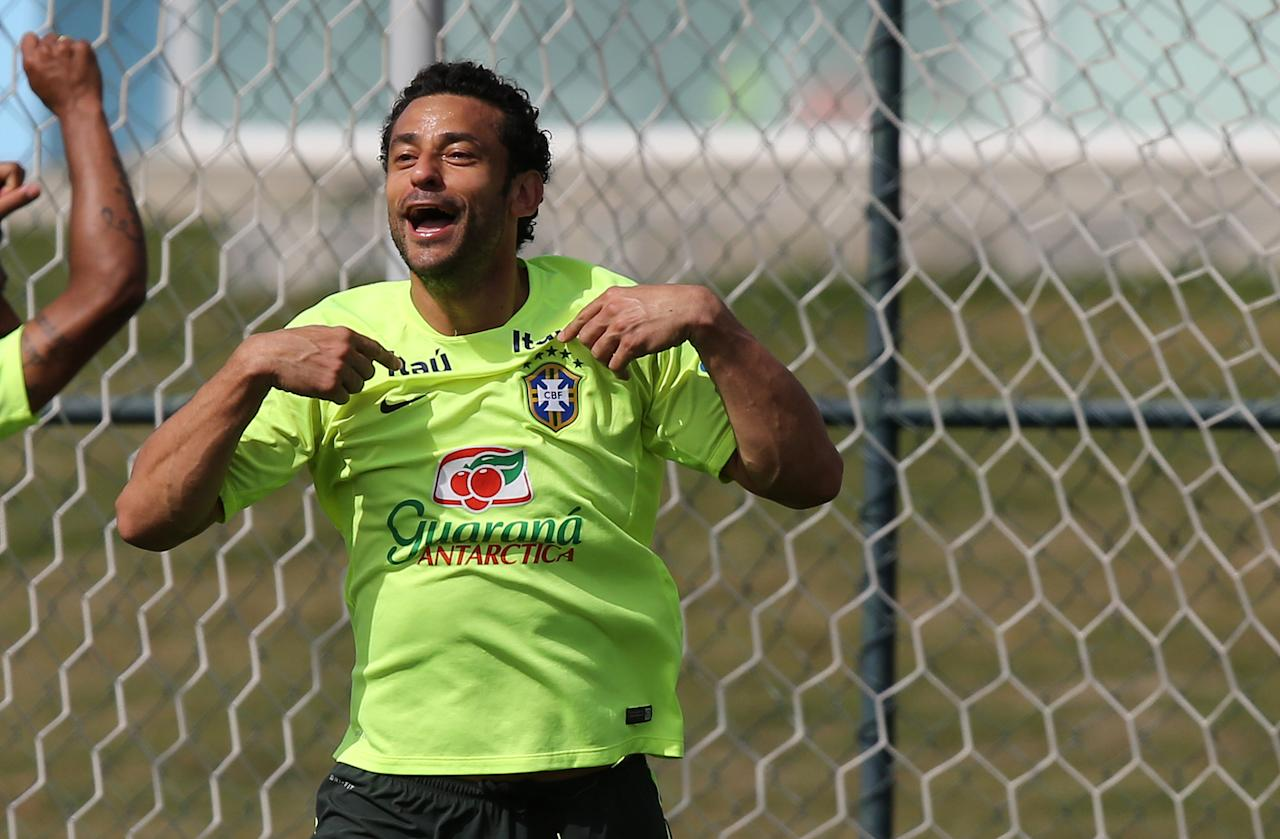 Brazil's Fred celebrates a goal scored during a practice session at the Granja Comary training center, in Teresopolis, Brazil, Monday, July 7, 2014. Brazil will face Germany on Tuesday in a World Cup semifinal match without Neymar. (AP Photo/Leo Correa)