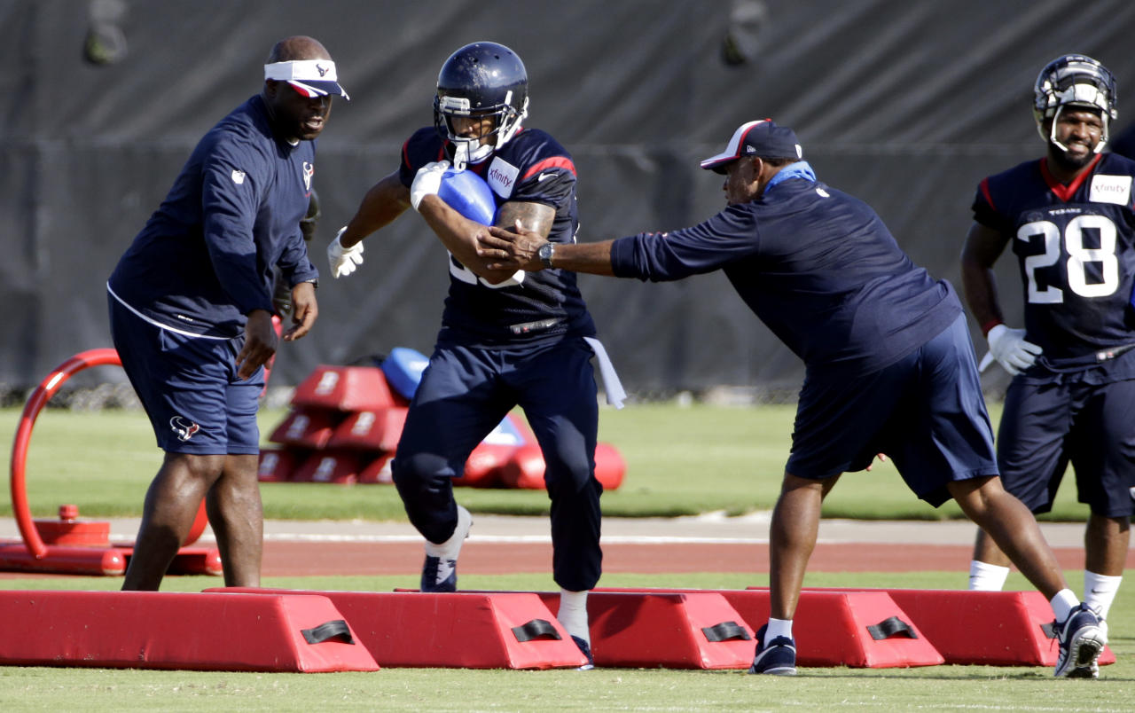 Houston Texans running back Arian Foster (23) goes through a drill during an NFL football training camp practice Sunday, July 27, 2014, in Houston. (AP Photo/David J. Phillip)