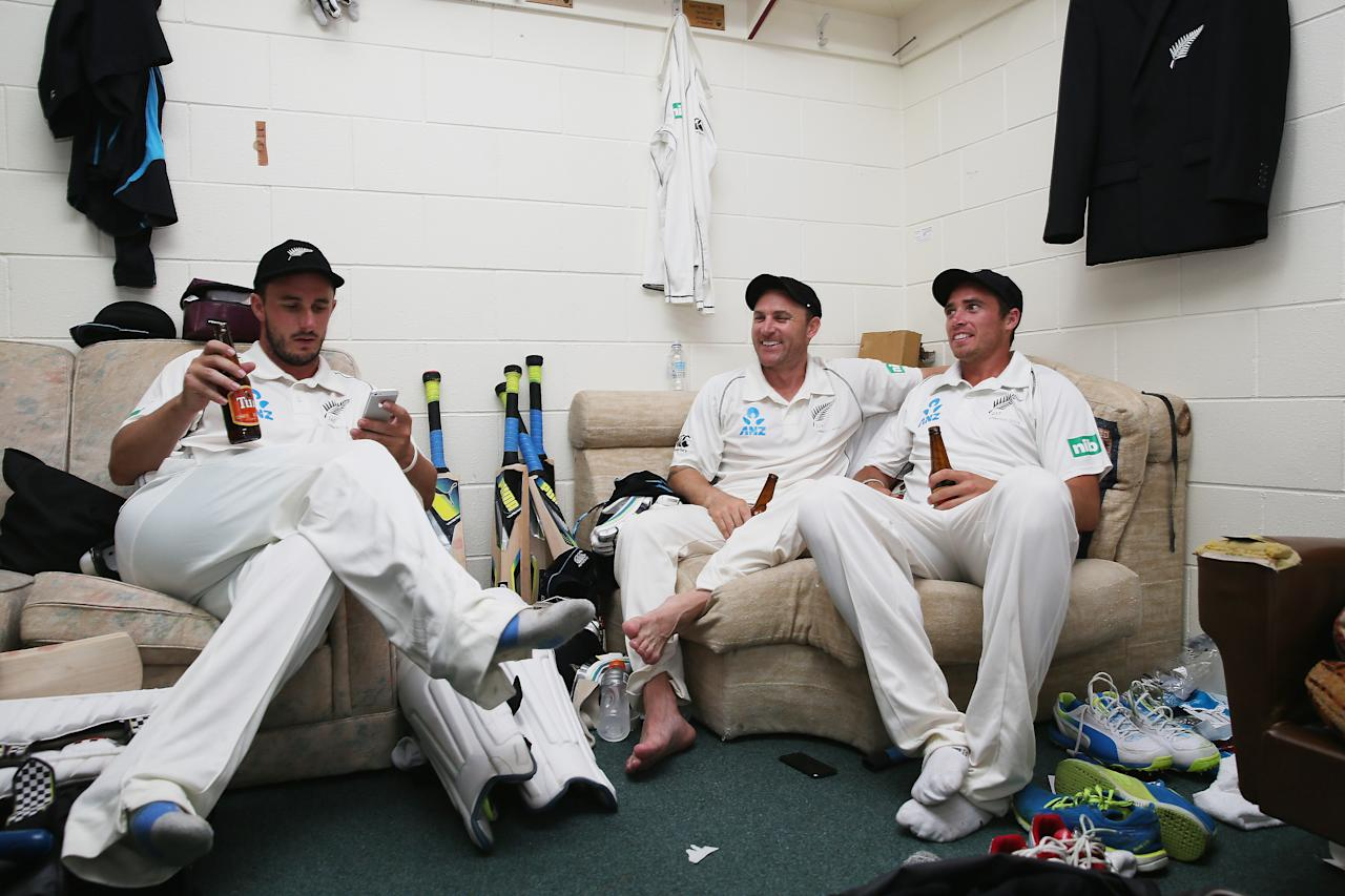HAMILTON, NEW ZEALAND - DECEMBER 22:  Hamish Rutherford, Brendon McCullum and Tim Southee of New Zealand celebrate in the dressing room after winning the Third Test match between New Zealand and the West Indies at Seddon Park on December 22, 2013 in Hamilton, New Zealand.  (Photo by Hannah Johnston/Getty Images)