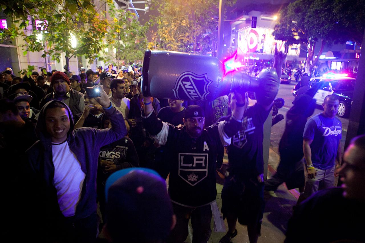 LOS ANGELES, CA - JUNE 11: Fans celebrate after the Los Angeles Kings defeated the New Jersey Devils to win the 2012 Stanley Cup Final June 11, 2012 in Los Angeles, California. The win is the Los Angeles Kings first championship in franchise history. (Photo by Jonathan Gibby/Getty Images)