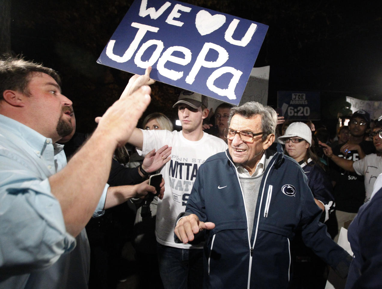 "Scott Paterno, left, looks on as students greet his father Penn State football coach Joe Paterno as he arrives at his home, Tuesday, Nov. 8, 2011, in State College, Pa. Paterno's support among the Penn State board of trustees was described as ""eroding"" Tuesday, threatening to end the 84-year-old coach's career amid a child sex-abuse scandal involving a former assistant and one-time heir apparent. (AP Photo/Matt Rourke)"