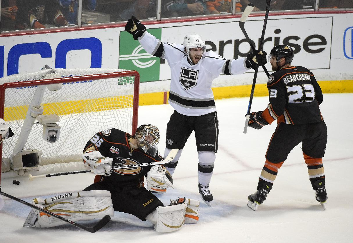 Los Angeles Kings center Mike Richards, center, celebrates his goal as Anaheim Ducks goalie John Gibson, left, and defenseman Francois Beauchemin react during the first period in Game 7 of an NHL hockey second-round Stanley Cup playoff series, Friday, May 16, 2014, in Anaheim, Calif. (AP Photo/Mark J. Terrill)