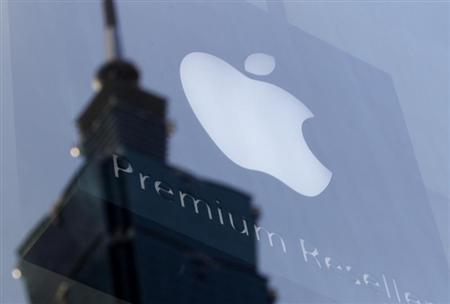 The Apple logo is seen against the reflection of Taiwan's landmark building Taipei 101