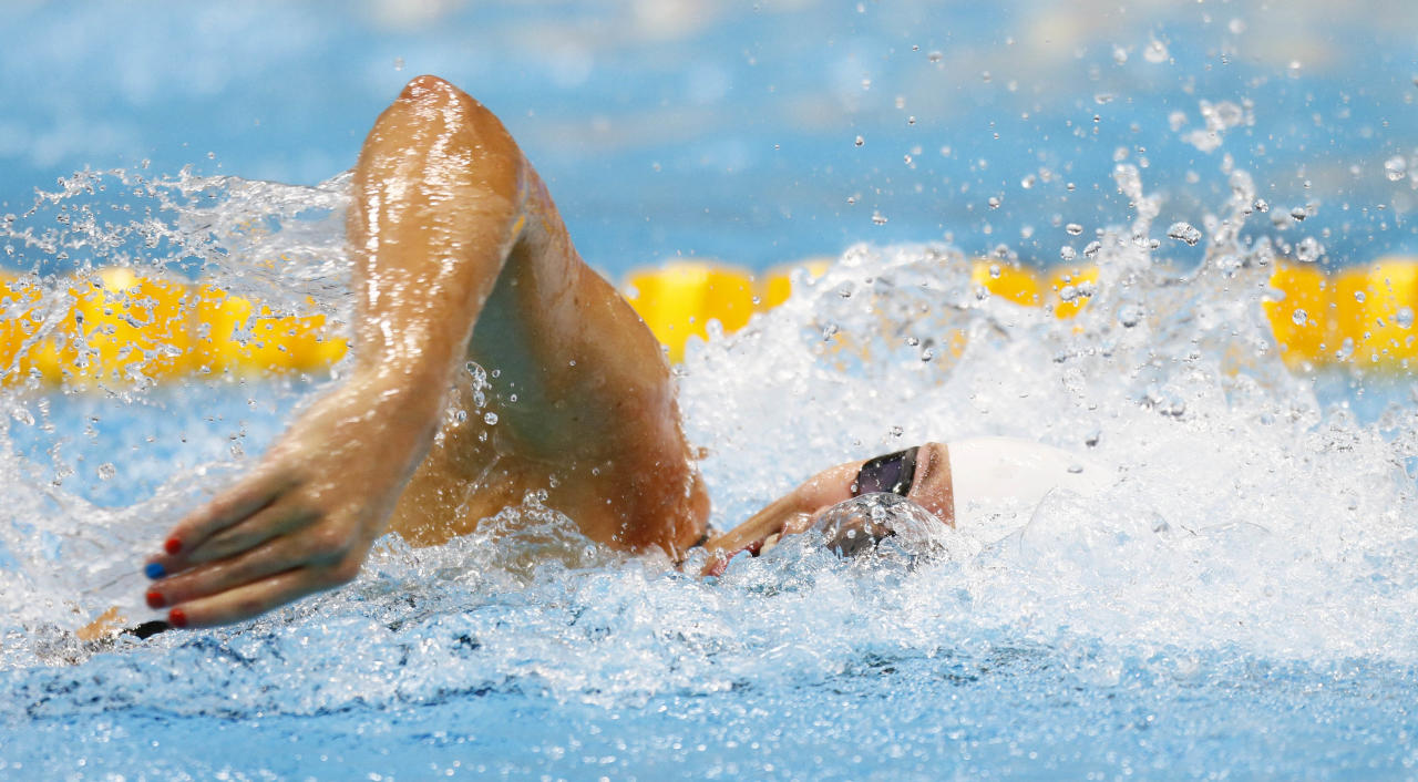 Jul 28, 2012; London, United Kingdom; Natalie Coughlin (USA) competes in her leg of a women's 4x100m freestyle relay heat during the 2012 London Olympic Games at Aquatics Centre. Mandatory Credit: Rob Schumacher-USA TODAY Sports