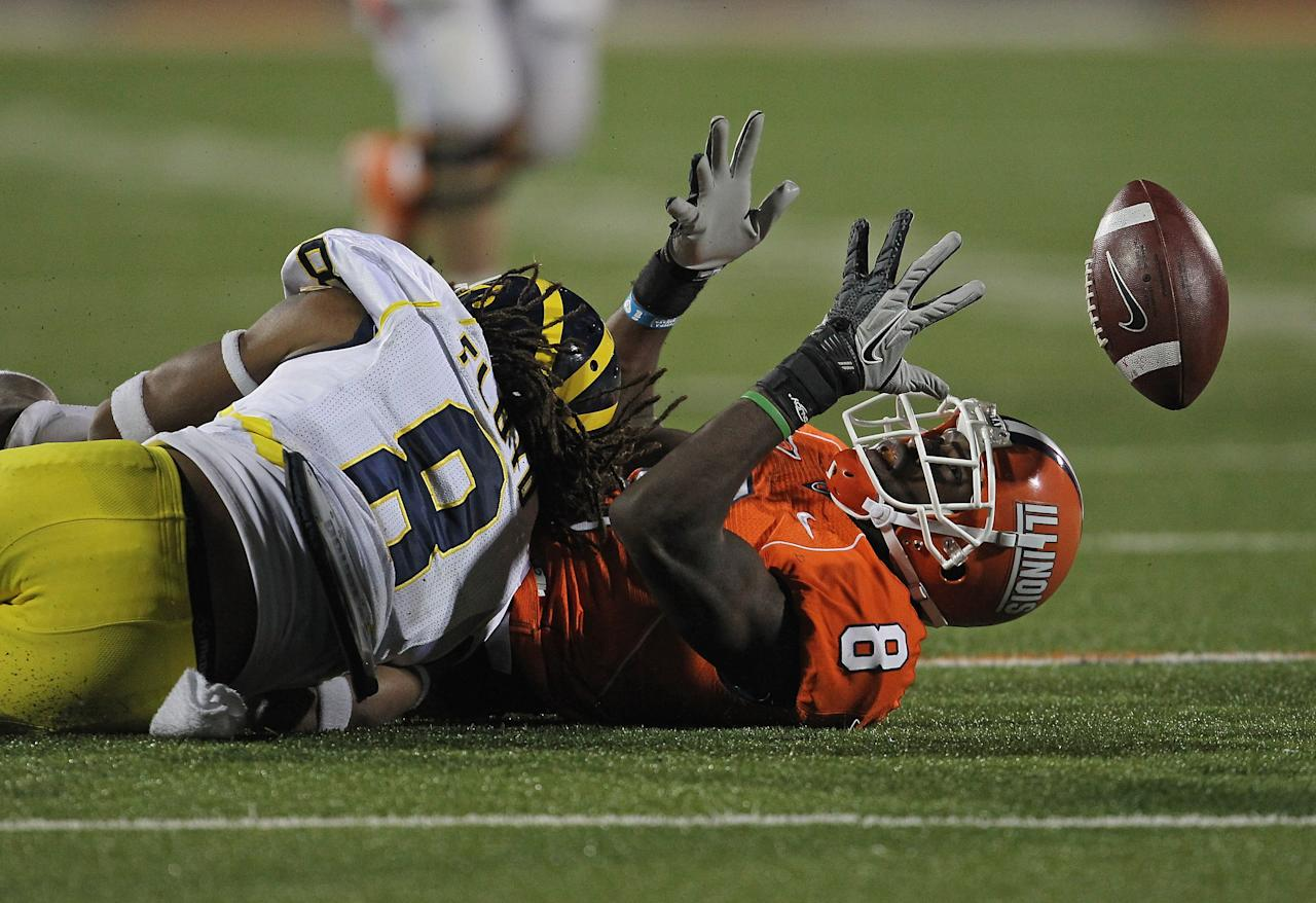 CHAMPAIGN, IL - NOVEMBER 12: A.J. Jenkins #8 of the Illinois Fighting Illini can't hold on to the ball after being hit by J.T. Floyd #8 of the Michigan Wolverines at Memorial Stadium on November 12, 2011 in Champaign, Illinois. Michigan defeated Illinois 31-14. (Photo by Jonathan Daniel/Getty Images)