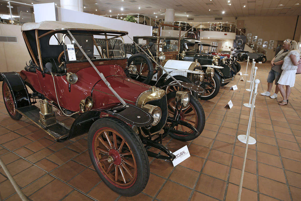 Visitors look at a Panhard X19 of 1913 from the collection of Prince Albert II of Monaco.