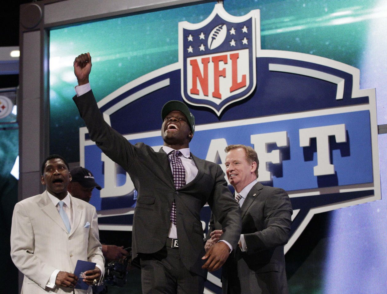 Georgia Tech wide reciever Stephen Hill celebrates as NFL Commissioner Roger Goodell, right, and Wesley Welker, left, watch after Hill was selected 43rd overall by the New York Jets in the second round of the NFL football draft at Radio City Music Hall, Friday, April 27, 2012, in New York. (AP Photo/Frank Franklin II)