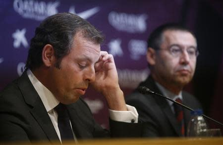 Barcelona president Sandro Rosell attends a news conference where he announced his resignation, next to vice-president Josep Maria Bartomeu, at Camp Nou stadium in Barcelona