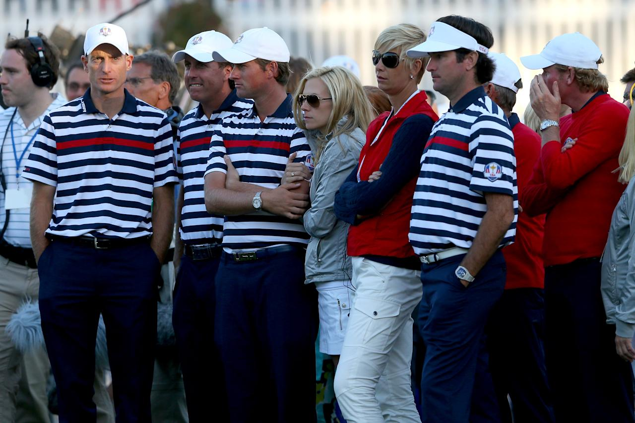 MEDINAH, IL - SEPTEMBER 30:  (L-R) Jim Furyk, Phil Mickelson, Webb Simpson and Bubba Watson wait with some of their team at the end of the Singles Matches for The 39th Ryder Cup at Medinah Country Club on September 30, 2012 in Medinah, Illinois.  (Photo by Mike Ehrmann/Getty Images)