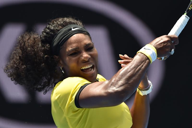 Serena Williams of the US hits a forehand return to Russia's Maria Sharapova during their Australian Open women's singles quarter-final match, in Melbourne, on January 26, 2016