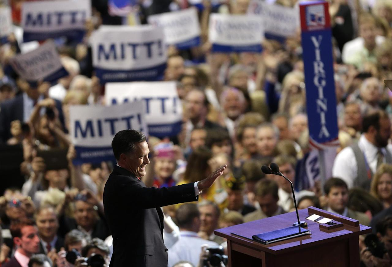 Republican presidential nominee Mitt Romney acknowledges delegates before speaking at the Republican National Convention in Tampa, Fla., on Thursday, Aug. 30, 2012. (AP Photo/Patrick Semansky)