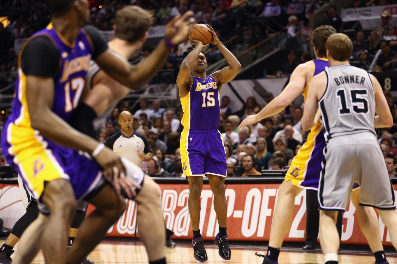 SAN ANTONIO, TX - APRIL 21:  Metta World Peace #15 of the Los Angeles Lakers takes a shot against the San Antonio Spurs during Game One of the Western Conference Quarterfinals of the 2013 NBA Playoffs at  at AT&T Center on April 21, 2013 in San Antonio, Texas. NOTE TO USER: User expressly acknowledges and agrees that, by downloading and or using this photograph, User is consenting to the terms and conditions of the Getty Images License Agreement.  (Photo by Ronald Martinez/Getty Images)