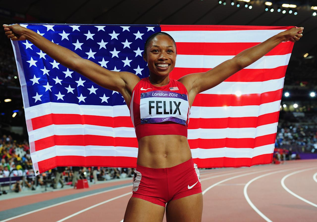 LONDON, ENGLAND - AUGUST 08:  Allyson Felix of the United States celebrates after winning gold in the Women's 200m Final on Day 12 of the London 2012 Olympic Games at Olympic Stadium on August 8, 2012 in London, England.  (Photo by Stu Forster/Getty Images)
