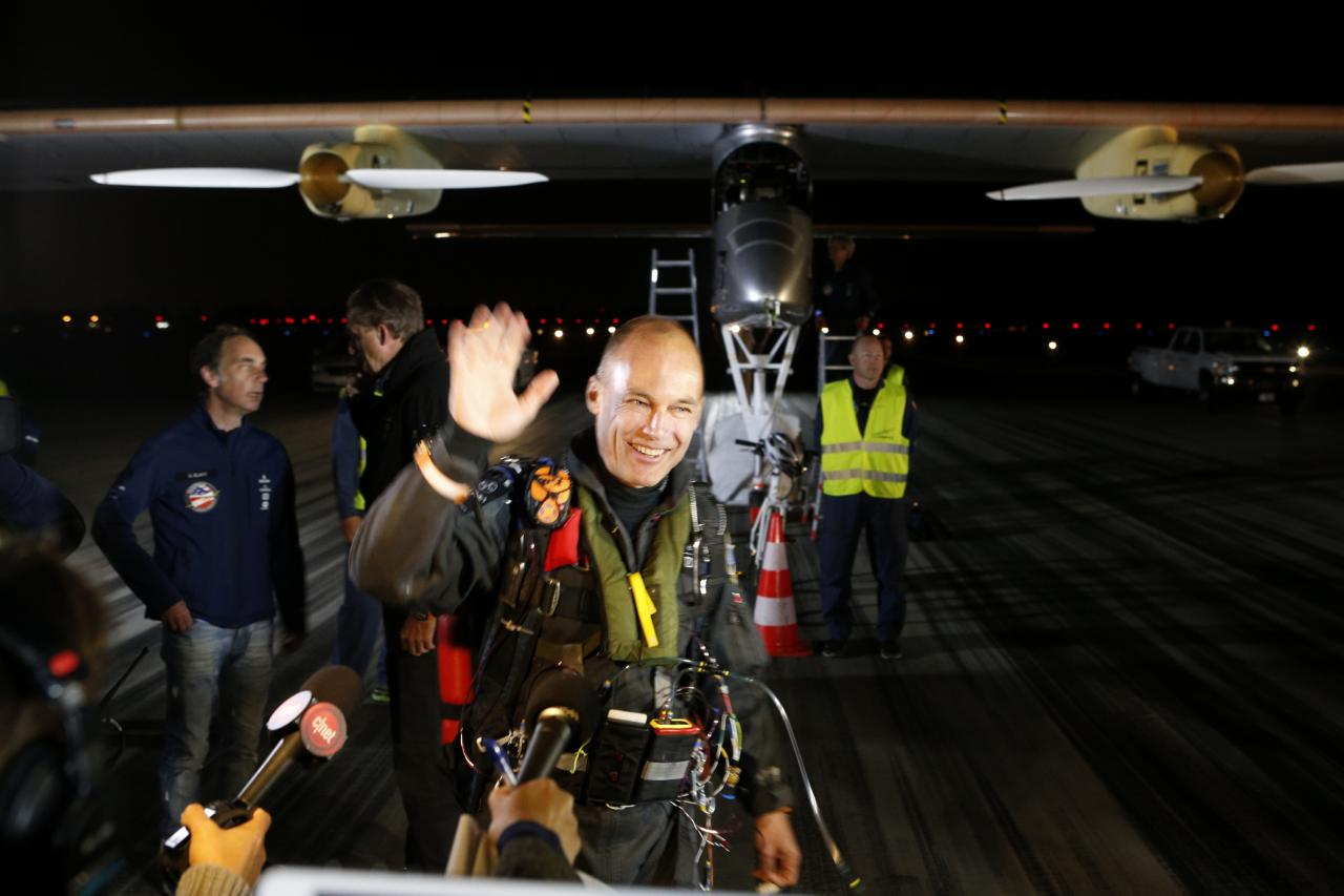 MOUNTAIN VIEW, CA - MAY 03: Pilot Bertrand Piccard  waves goodbye before taking off in the Solar Impulse solar electric airplane at Moffett Field on May 3, 2013 in Mountain View, California. Pilots Bertrand Piccard and Andre Borschberg are attempting the first cross-continental flight in a solar powered plane that can travel day and night. (Photo by Beck Diefenbach/Getty Images)