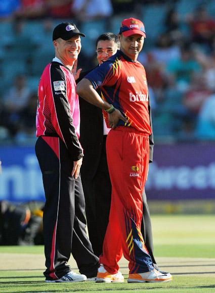 Brad Haddin (L) of the Sixers and Alviro Petersen of the Lions before the toss of the coin during the Karbonn Smart CLT20 Final match between bizhub Highveld Lions and Sydney Sixers at Bidvest Wanderers Stadium on October 28, 2012 in Johannesburg, South Africa. (Photo by Duif du Toit/Gallo Images/Getty Images)