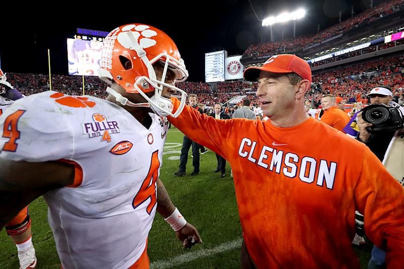 Clemson quarterback Deshaun Watson and coach Dabo Swinney celebrate after winning the national title. (Getty