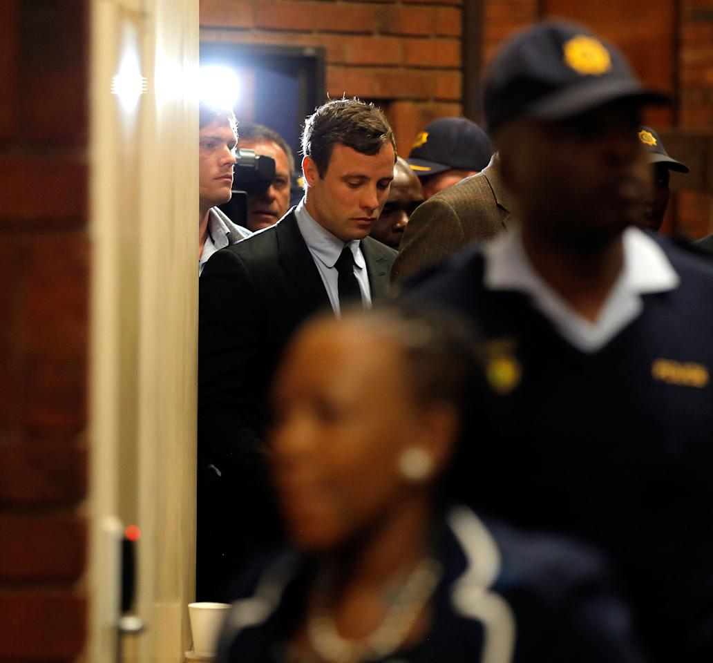 PRETORIA, SOUTH AFRICA - AUGUST 19: South African athlete Oscar Pistorius leaves the Pretoria Magistrates Court after an indictment hearing on August 19, 2013 in Pretoria, South Africa. Pistorius, 26 is accused of murdering his girlfriend Reeva Steenkamp which Pistorius denies claiming he mistook Steenkamp for an intruder. The indictment was served and the trial date of March 3, 2014 was set in Pretoria Magistrates Court. (Photo by Jemal Countess/Getty Images)