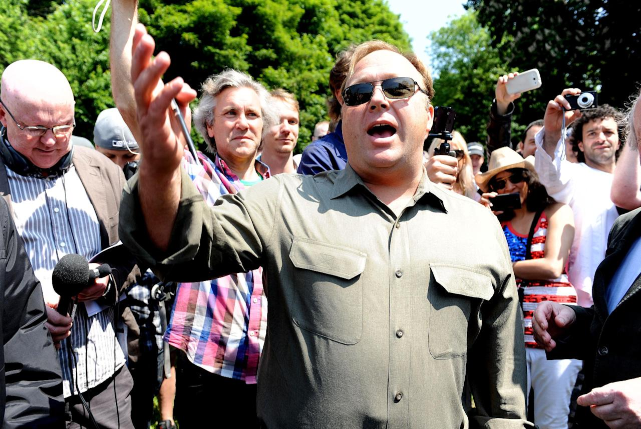 American radio host, author, conspiracy theorist and documentary filmmaker Alex Jones, speaks to the media outside the Grove Hotel, in Watford where The Bilderberg Group summit meeting is being held, attended by royalty, politicians, billionaire investors, banking and corporate CEOs, policy-makers and media moguls from all over the world.