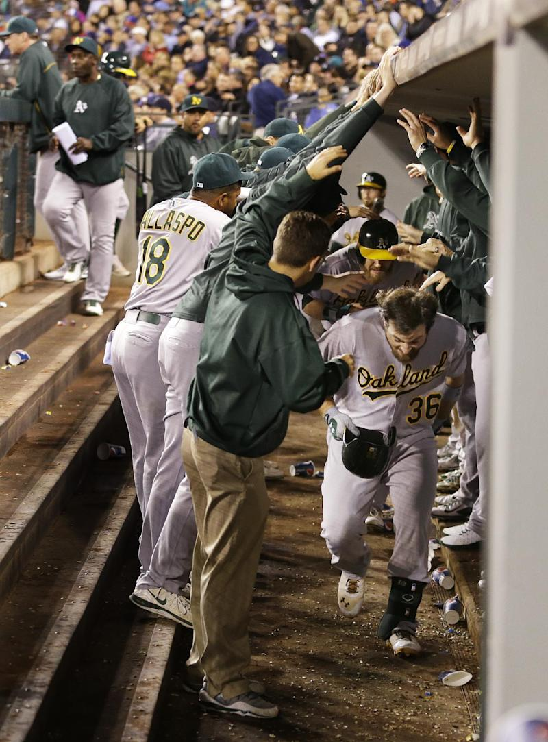 Colon's 18th win leads Athletics over Mariners 8-2