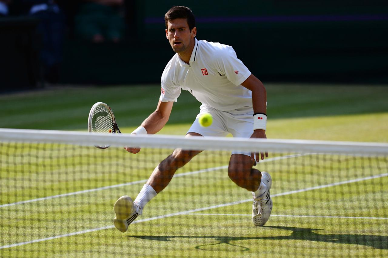 LONDON, ENGLAND - JULY 05: Novak Djokovic of Serbia plays a forehand during the Gentlemen's Singles semi-final match against Juan Martin Del Potro of Argentina on day eleven of the Wimbledon Lawn Tennis Championships at the All England Lawn Tennis and Croquet Club on July 5, 2013 in London, England. (Photo by Mike Hewitt/Getty Images)