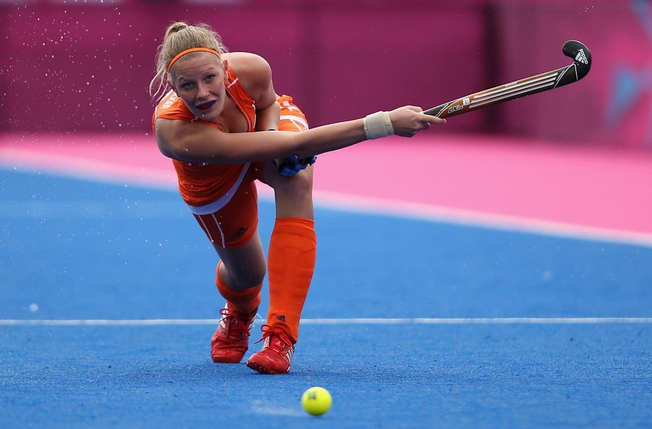 LONDON, ENGLAND - JULY 29:   Caia Van Maasakker of Netherlands competes during the Women's Pool WA Match W02 between the Netherlands and Belgium at the Hockey Centre on July 29, 2012 in London, England.  (Photo by Daniel Berehulak/Getty Images)