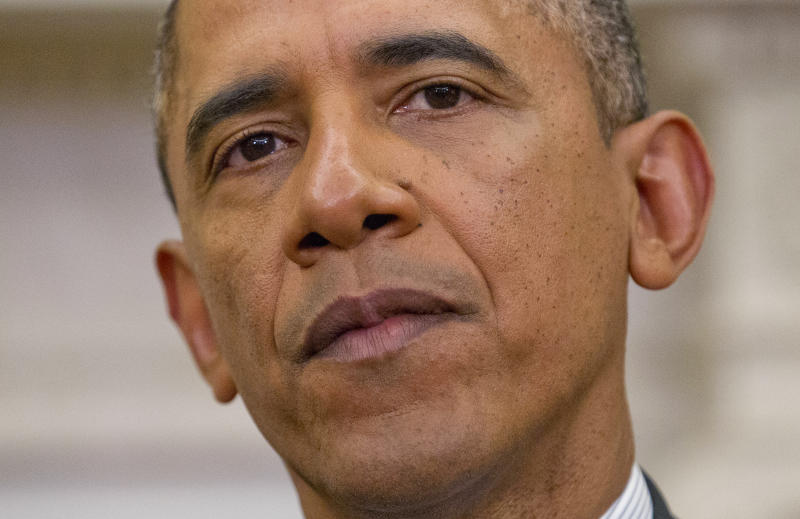 Obama signs memo to strengthen overtime pay rules