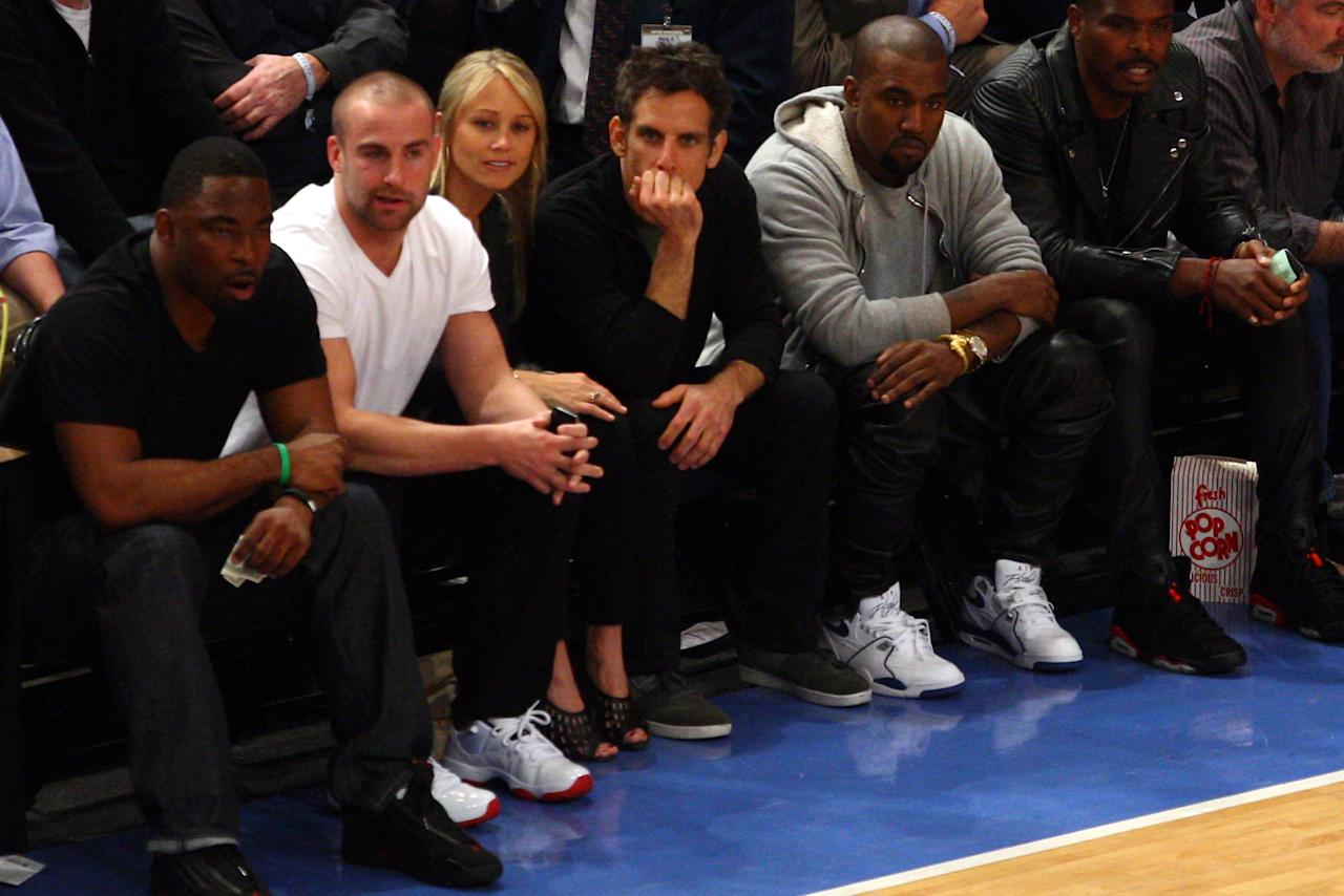 NEW YORK, NY - MAY 03:  (L-R starting 3rd L) Actress Christine Taylor, actor Ben Stiller and Hip-Hop artist Kanye West sit courtside and watch the New York Knicks host the Miami Heat in Game Three of the Eastern Conference Quarterfinals in the 2012 NBA Playoffs on May 3, 2012 at Madison Square Garden in New York City.  NOTE TO USER: User expressly acknowledges and agrees that, by downloading and or using this photograph, User is consenting to the terms and conditions of the Getty Images License Agreement.  (Photo by Chris Chambers/Getty Images)