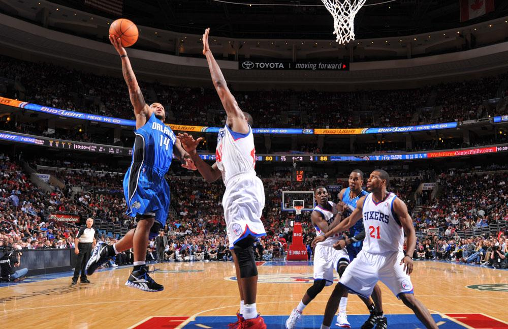 PHILADELPHIA, PA - APRIL 7:  Jameer Nelson #14 of the Orlando Magic shoots over Elton Brand #42 of the Philadelphia 76ers on April 7, 2012 at the Wells Fargo Center in Philadelphia, Pennsylvania.    NOTE TO USER: User expressly acknowledges and agrees that, by downloading and/or using this Photograph, user is consenting to the terms and conditions of the Getty Images License Agreement. Mandatory Copyright Notice: Copyright 2012 NBAE