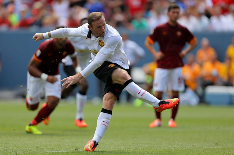 Manchester United's Wayne Rooney scores from the penalty spot during a 3-2 International Champions Cup win against AS Roma at Sports Authority Field at Mile High on July 26, 2014 in Denver, Colorado