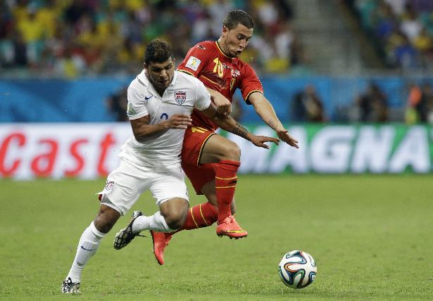 United States' DeAndre Yedlin, left, challenges Belgium's Eden Hazard during the World Cup round of 16 soccer match between Belgium and the USA at the Arena Fonte Nova in Salvador, Brazil, Tuesday, July 1, 2014. (AP Photo/Matt Dunham)