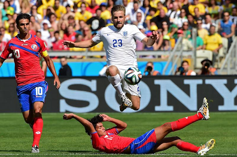 England full-back Luke Shaw (top) in action during a World Cup Group D match against Costa Rica at the Mineirao Stadium in Belo Horizonte, on June 24, 2014