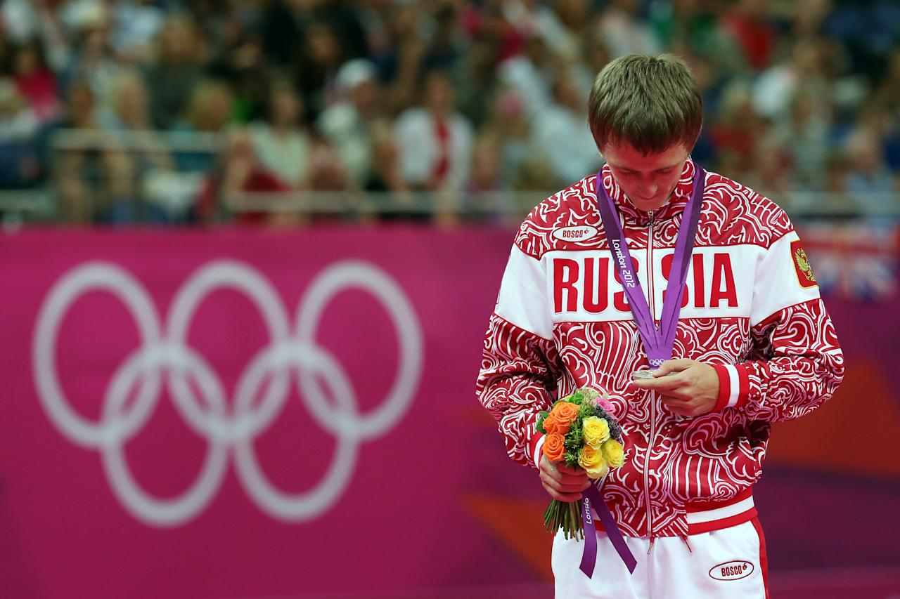 LONDON, ENGLAND - AUGUST 03:  (L-R) Silver medalist Dmitry Ushakov of Russian poses on the podium during the medal ceremony for the Men's Trampoline during Day 7 of the London 2012 Olympic Games at North Greenwich Arena on August 3, 2012 in London, England.  (Photo by Ronald Martinez/Getty Images)