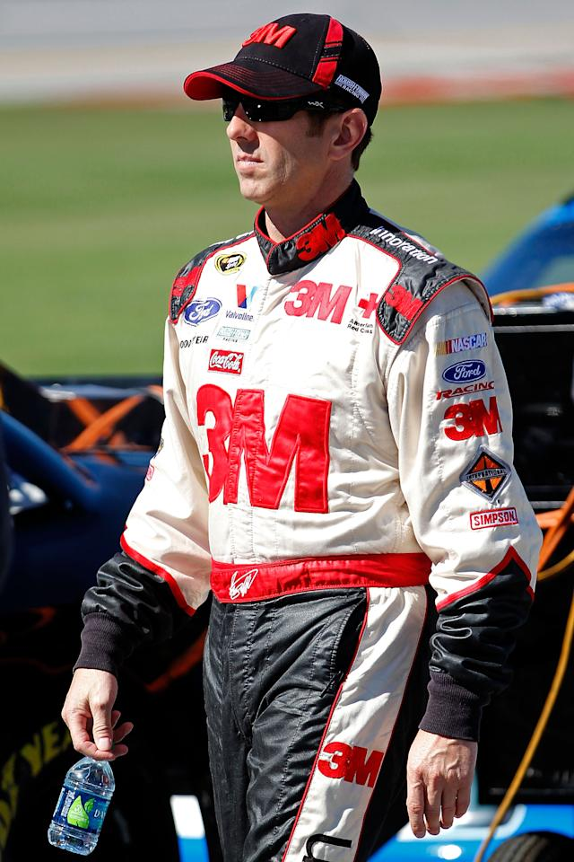 TALLADEGA, AL - OCTOBER 22:  Greg Biffle, driver of the #16 3M/O'Reilly Auto Parts Ford, walks on pit road during qualifying for the NASCAR Sprint Cup Series Good Sam Club 500 at Talladega Superspeedway on October 22, 2011 in Talladega, Alabama.  (Photo by Geoff Burke/Getty Images for NASCAR)