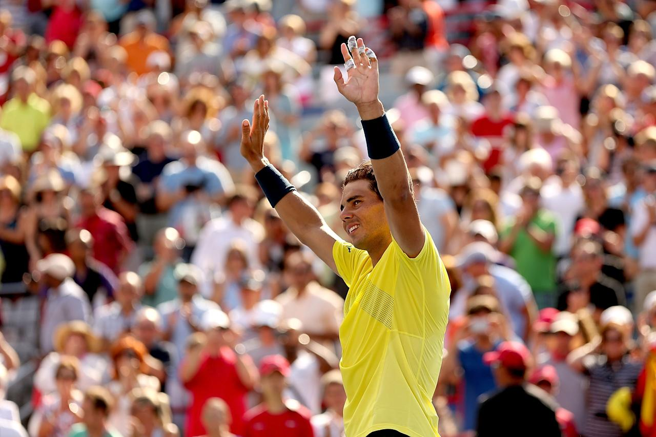 MONTREAL, QC - AUGUST 11: Rafael Nadal of Spain celebrates his win over Milos Roanic of Canada during the final of the Rogers Cup at Uniprix Stadium on August 11, 2013 in Montreal, Quebec, Canada. (Photo by Matthew Stockman/Getty Images)
