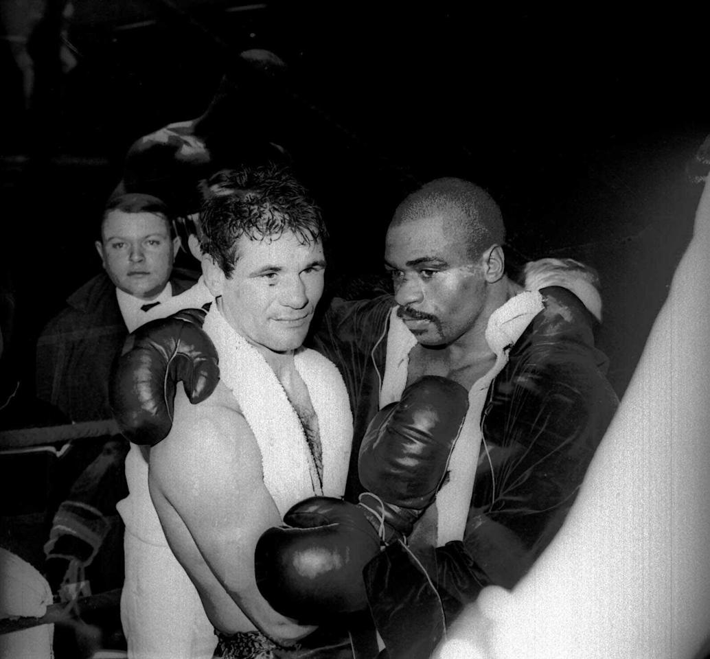"""FILE - In this Feb. 23, 1965 file photo, Rubin """"Hurricane"""" Carter and Italian boxer Fabio Bettini pose after a fight at the Palais des Sports in Paris. Carter, who spent almost 20 years in jail after twice being convicted of a triple murder he denied committing, died at his home in Toronto, Sunday, April 20, 2014, according to long-time friend and co-accused John Artis. He was 76. (AP photo/Bedini, File)"""