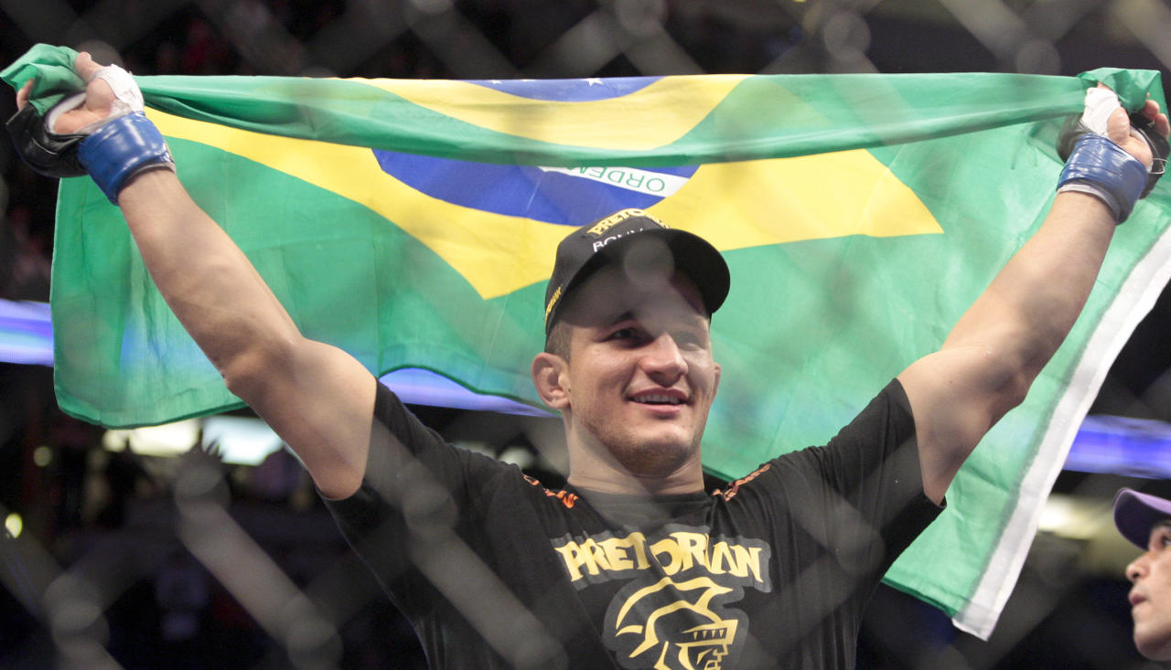 Junior dos Santos, of Brazil, celebrates after defeating Cain Velasquez in the UFC mixed martial arts heavyweight title bout in Anaheim, Calif., Saturday, Nov. 12, 2011. Dos Santos won by knockout in the first round. (AP Photo/Jason Redmond)