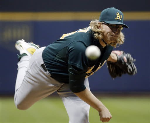 Brewers rally in 10th for 4-3 victory over A's